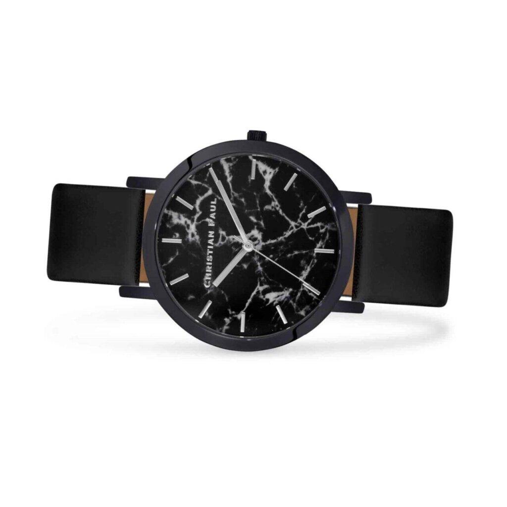 """סטרנד שעון לנשים במידה 35מ""""מ שעון מיוחד לנשים עם רקע שחור וייחודי בטקסטורת שיש."""