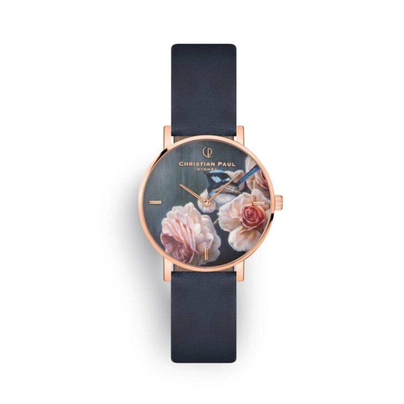 """שעון לנשים """"בלו וורן"""" בצבע רוז גולד עם רקע פריחה וגדרון כחול, רצועה מעור ז'מש בצבע כחול נייבי"""